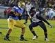 Oct 12, 2013; Pasadena, CA, USA; UCLA Bruins quarterback Brett Hundley (17) gets tackled by California Golden Bears safety Michael Lowe (5) during second quarter at Rose Bowl.  Mandatory Credit: Robert Hanashiro-USA TODAY Sports