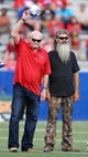 Sep 12, 2013; Ruston, LA, USA; Former NFL quarterback Terry Bradshaw, left, and television personality Phil Robertson are honored during a ceremony at Joe Aillet Stadium between the Louisiana Tech Bulldogs and the Tulane Green Wave. Both men played quarterback for Louisiana Tech. Mandatory Credit: Chuck Cook-USA TODAY Sports