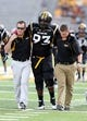 Oct 5, 2013; Hattiesburg, MS, USA; Southern Miss Golden Eagles defensive tackle Jerry Harris (93) is helped off the field after an injury during pre-game warm-ups before their game against the FIU Golden Panthers at M.M. Roberts Stadium. Mandatory Credit: Chuck Cook-USA TODAY Sports