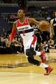Oct 8, 2013; Washington, DC, USA; Washington Wizards point guard John Wall (2) dribbles the ball against the Brooklyn Nets at Verizon Center. Mandatory Credit: Geoff Burke-USA TODAY Sports