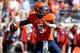 Oct 5, 2013; Charlottesville, VA, USA; Virginia Cavaliers quarterback David Watford (5) throws the ball against the Ball State Cardinals at Scott Stadium. Mandatory Credit: Geoff Burke-USA TODAY Sports