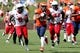 Oct 5, 2013; Charlottesville, VA, USA; Virginia Cavaliers running back Khalek Shepherd (23) carries the ball as Ball State Cardinals cornerback Eric Patterson (5) chases at Scott Stadium. Mandatory Credit: Geoff Burke-USA TODAY Sports
