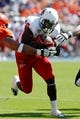 Oct 5, 2013; Charlottesville, VA, USA; Ball State Cardinals running back Jahwan Edwards (32) carries the ball against the Virginia Cavaliers at Scott Stadium. Mandatory Credit: Geoff Burke-USA TODAY Sports