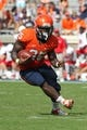 Oct 5, 2013; Charlottesville, VA, USA; Virginia Cavaliers running back Kevin Parks (25) carries the ball against the Ball State Cardinals at Scott Stadium. Mandatory Credit: Geoff Burke-USA TODAY Sports
