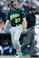 Oct 8, 2013; Detroit, MI, USA; Oakland Athletics first baseman Brandon Moss (37) walks back to the dugout after striking out against the Detroit Tigers in game four of the American League divisional series at Comerica Park. Mandatory Credit: Rick Osentoski-USA TODAY Sports
