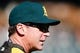 Oct 8, 2013; Detroit, MI, USA; Oakland Athletics manager Bob Melvin (6) during batting practice before game four of the American League divisional series against the Detroit Tigers at Comerica Park. Mandatory Credit: Rick Osentoski-USA TODAY Sports