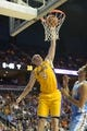 Oct 8, 2013; Ontario, CA, USA; Los Angeles Lakers center Chris Kaman (9) dunks the all against the Denver Nuggets at Citizens Business Bank Arena. Mandatory Credit: Kirby Lee-USA TODAY Sports