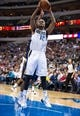 Oct 7, 2013; Dallas, TX, USA; Dallas Mavericks shooting guard D.J. Kennedy (12) drives to the basket during the game against the New Orleans Pelicans at the American Airlines Center. The Pelicans defeated the Mavericks 94-92. Mandatory Credit: Jerome Miron-USA TODAY Sports