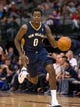 Oct 7, 2013; Dallas, TX, USA; New Orleans Pelicans small forward Al-Farouq Aminu (0) brings the ball up the court during the game against the Dallas Mavericks at the American Airlines Center. The Pelicans defeated the Mavericks 94-92. Mandatory Credit: Jerome Miron-USA TODAY Sports