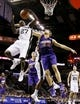 Oct 13, 2013; San Antonio, TX, USA; San Antonio Spurs guard Courtney Fells (27) pulls down a rebound over Phoenix Suns center Viacheslav Kravtsov (55) during the second half at AT&T Center. The Suns won 106-99. Mandatory Credit: Soobum Im-USA TODAY Sports