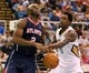 Oct 13, 2013; Biloxi, MS, USA; Atlanta Hawks shooting guard Damien Wilkins (2) is fouled by New Orleans Pelicans small forward Al-Farouq Aminu (0) during the first half of their game at the Mississippi Coast Coliseum. Mandatory Credit: Chuck Cook-USA TODAY Sports