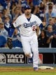 October 14, 2013; Los Angeles, CA, USA; Los Angeles Dodgers first baseman Adrian Gonzalez (23) celebrates the 3-0 victory against the St. Louis Cardinals in game three of the National League Championship Series baseball game at Dodger Stadium. Mandatory Credit: Jayne Kamin-Oncea-USA TODAY Sports