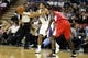Oct 14, 2013; Sacramento, CA, USA; Sacramento Kings point guard Ray McCallum (3) passes the ball against Los Angeles Clippers point guard Darren Collison (2) during the third quarter at Sleep Train Arena. The Sacramento Kings defeated the Los Angeles Clippers 99-88. Mandatory Credit: Kelley L Cox-USA TODAY Sports