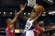 Oct 14, 2013; Sacramento, CA, USA; Sacramento Kings point guard Isaiah Thomas (22) looks to pass the ball between Los Angeles Clippers shooting guard Willie Green (34) and shooting guard Jamal Crawford (11) during the fourth quarter at Sleep Train Arena. The Sacramento Kings defeated the Los Angeles Clippers 99-88. Mandatory Credit: Kelley L Cox-USA TODAY Sports