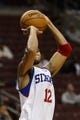 Oct 14, 2013; Philadelphia, PA, USA; Philadelphia 76ers guard Evan Turner (12) shoots a jump shot during the fourth quarter against the Brooklyn Nets at Wells Fargo Center. The Nets defeated the Sixers 127-97. Mandatory Credit: Howard Smith-USA TODAY Sports