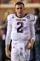 Oct 12, 2013; Oxford, MS, USA; Texas A&M Aggies quarterback Johnny Manziel (2) on the sidelines during the game against the Mississippi Rebels at Vaught-Hemingway Stadium. Texas A&M Aggies defeated the Mississippi Rebels 41-48.  Mandatory Credit: Spruce Derden-USA TODAY Sports