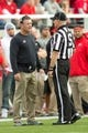 Oct 12, 2013; Salt Lake City, UT, USA; Utah Utes head coach Kyle Whittingham talks with an official during the first half against the Stanford Cardinal at Rice-Eccles Stadium. Utah defeated Stanford 27-21. Mandatory Credit: Russ Isabella-USA TODAY Sports
