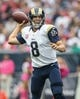 Oct 13, 2013; Houston, TX, USA; St. Louis Rams quarterback Sam Bradford (8) looks for an open receiver during the second quarter against the Houston Texans at Reliant Stadium. Mandatory Credit: Troy Taormina-USA TODAY Sports