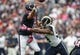 Oct 13, 2013; Houston, TX, USA; St. Louis Rams defensive end Robert Quinn (94) applies pressure to Houston Texans quarterback Matt Schaub (8) during the first quarter at Reliant Stadium. Mandatory Credit: Troy Taormina-USA TODAY Sports