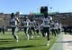 Oct 5, 2013; Boulder, CO, USA; Members of the Oregon Ducks run off the field before the game against the Colorado Buffaloes at Folsom Field. Mandatory Credit: Ron Chenoy-USA TODAY Sports
