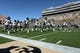 Oct 5, 2013; Boulder, CO, USA; Members of the Oregon Ducks warm up on the field before the start of the game against the Colorado Buffaloes at Folsom Field. Mandatory Credit: Ron Chenoy-USA TODAY Sports
