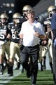 Oct 5, 2013; Boulder, CO, USA; Colorado Buffaloes head coach Mike Macintyre takes to the field before the start of the game against the Oregon Ducks at Folsom Field. Mandatory Credit: Ron Chenoy-USA TODAY Sports