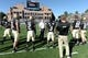 Oct 5, 2013; Boulder, CO, USA; Colorado Buffaloes head coach Mike Macintyre (center) walks the field before the start of the game against the Oregon Ducks at Folsom Field. Mandatory Credit: Ron Chenoy-USA TODAY Sports