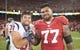 Oct 6, 2013; San Francisco, CA, USA; Houston Texans free safety Shiloh Keo (31) and San Francisco 49ers guard Mike Iupati (77) smile for the camera after the game between the Houston Texans and San Francisco 49ers at Candlestick Park. Mandatory Credit: Ed Szczepanski-USA TODAY Sports