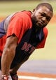 Oct 7, 2013; St. Petersburg, FL, USA; Boston Red Sox designated hitter David Ortiz (34) against the Tampa Bay Rays  works out prior to game three of the American League divisional series at Tropicana Field. Mandatory Credit: Kim Klement-USA TODAY Sports