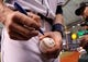 Oct 7, 2013; St. Petersburg, FL, USA; A detailed view of Tampa Bay Rays right fielder Wil Myers (9) signing an autograph on a baseball prior to the game against the Boston Red Sox of game three of the American League divisional series at Tropicana Field. Mandatory Credit: Kim Klement-USA TODAY Sports
