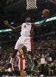 Oct 16, 2013; Toronto, Ontario, CAN; Toronto Raptors forward Quincy Acy (4) gets a rebound against the Boston Celtics during the second half at Air Canada Centre. Toronto defeated Boston 99-97. Mandatory Credit: John E. Sokolowski-USA TODAY Sports