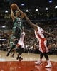 Oct 16, 2013; Toronto, Ontario, CAN; Boston Celtics guard Courtney Lee (11) goes up for a basket as Toronto Raptors guard Dwight Buycks (13) defends during the second half at Air Canada Centre. Toronto defeated Boston 99-97. Mandatory Credit: John E. Sokolowski-USA TODAY Sports