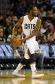 Oct 17, 2013; Charlotte, NC, USA; Charlotte Bobcats forward Michael Kidd-Gilchrist (14) looks to pass the ball during the pre season game against the Philadelphia 76ers at Time Warner Cable Arena. Mandatory Credit: Sam Sharpe-USA TODAY Sports