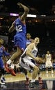 Oct 17, 2013; Charlotte, NC, USA; Charlotte Bobcats forward Cody Zeller (40) looks to shoot as he is defended by Philadelphia 76ers forward Gani Lawal (42) during the pre season game at Time Warner Cable Arena. Bobcats win 110-84. Mandatory Credit: Sam Sharpe-USA TODAY Sports