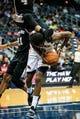 Oct 17, 2013; Atlanta, GA, USA; Atlanta Hawks small forward DeMarre Carroll (5) is fouled by San Antonio Spurs shooting guard Danny Green (4) in the first half at Philips Arena. Mandatory Credit: Daniel Shirey-USA TODAY Sports