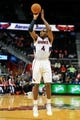 Oct 17, 2013; Atlanta, GA, USA; Atlanta Hawks power forward Paul Millsap (4) shoot a basket in the first half against the San Antonio Spurs at Philips Arena. Mandatory Credit: Daniel Shirey-USA TODAY Sports
