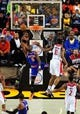 Oct 17, 2013; Baltimore, MD, USA; New York Knicks guard Tim Hardaway Jr. (5) lays the ball up over Washington Wizards forward Kevin Seraphin (13) at Baltimore Arena. Mandatory Credit: Evan Habeeb-USA TODAY Sports