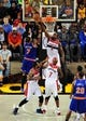 Oct 17, 2013; Baltimore, MD, USA; New York Knicks forward Carmelo Anthony (7) shoots the ball over Washington Wizards forward Martell Webster (9) at Baltimore Arena. Mandatory Credit: Evan Habeeb-USA TODAY Sports