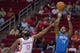 Oct 16, 2013; Houston, TX, USA; Orlando Magic point guard Jameer Nelson (14) shoots over Houston Rockets shooting guard James Harden (13) during the first half at Toyota Center. Mandatory Credit: Thomas Campbell-USA TODAY Sports