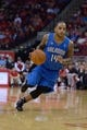 Oct 16, 2013; Houston, TX, USA; Orlando Magic point guard Jameer Nelson (14) dribbles against the Houston Rockets during the first half at Toyota Center. Mandatory Credit: Thomas Campbell-USA TODAY Sports