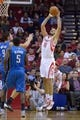 Oct 16, 2013; Houston, TX, USA; Houston Rockets small forward Omri Casspi (18) grabs a rebound against the Orlando Magic during the first half at Toyota Center. Mandatory Credit: Thomas Campbell-USA TODAY Sports