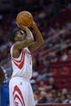 Oct 16, 2013; Houston, TX, USA; Houston Rockets point guard Aaron Brooks (0) shoots a free throw against the Orlando Magic during the second half at Toyota Center. The Rockets won 108-104. Mandatory Credit: Thomas Campbell-USA TODAY Sports