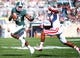 Oct 12, 2013; East Lansing, MI, USA; Michigan State Spartans wide receiver Tony Lippett (14) runs for yards after the catch against Indiana Hoosiers cornerback Michael Hunter (17) during the first half in a game at Spartan Stadium. Mandatory Credit: Mike Carter-USA TODAY Sports