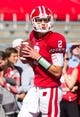 Oct 12, 2013; Madison, WI, USA; Wisconsin Badgers quarterback Joel Stave (2) during warmups prior to the game against the Northwestern Wildcats at Camp Randall Stadium.  Wisconsin won 35-6.  Mandatory Credit: Jeff Hanisch-USA TODAY Sports