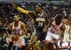 Oct 18, 2013; Chicago, IL, USA; Chicago Bulls forward Taj Gibson shoots past the Indiana Pacers center Ian Mahinmi as Tony Snell looks on at the United Center. Mandatory Credit: Matt Marton-USA TODAY Sports