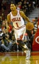 Oct 18, 2013; Chicago, IL, USA; Chicago Bulls guard Derrick Rose dribbles against the Indian Pacers at the United Center. Mandatory Credit: Matt Marton-USA TODAY Sports