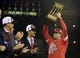 Oct 18, 2013; St. Louis, MO, USA; St. Louis Cardinals manager Mike Matheny (right) hoists National League championship trophy after game six of the National League Championship Series baseball game against the Los Angeles Dodgers at Busch Stadium. Mandatory Credit: Jeff Curry-USA TODAY Sports