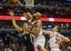 Oct 18, 2013; Chicago, IL, USA; Indiana Pacers forward Luis Scola shoots over Chicago Bulls forward Taj Gibson and forward Erik Murphy at the United Center. Mandatory Credit: Matt Marton-USA TODAY Sports