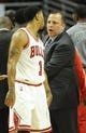 Oct 18, 2013; Chicago, IL, USA; Chicago Bulls guard Derrick Rose  talks with coach Tom Thibodeau against the Indiana Pacers at the United Center. Mandatory Credit: Matt Marton-USA TODAY Sports