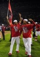 Oct 18, 2013; St. Louis, MO, USA; St. Louis Cardinals players Carlos Martinez (left) and Jon Jay celebrate after game six of the National League Championship Series baseball game against the Los Angeles Dodgers at Busch Stadium. Mandatory Credit: Jeff Curry-USA TODAY Sports